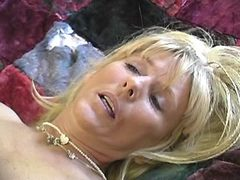 Blond mature gets licked and fucked
