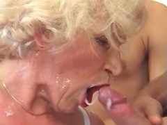 Blond aged woman eating cum in orgy