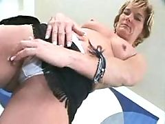 Lovely mom rubs her pussy