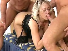 Mama gangbangs with two horny studs