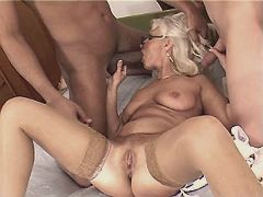 Blonde aged mature sucks two cocks