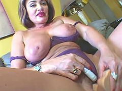 Lustful busty matron with vibrator