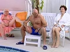 Granny in white bathrobe sucks cock