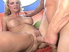 Redhaired mature has fun with guys